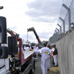 Loading the wrecked #3 Audi R18 onto a flatbed