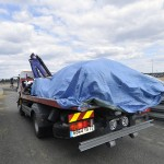 "Covered and loaded Audi R18 TDI after a massive wreck at ""The Esses"""