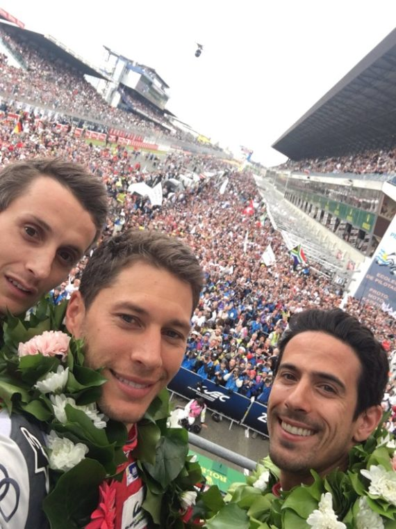The third place Audi team from the podium with an estimaged 35,000 fans in the background. But the team did not really want to be on the podium -- knowing that the Toyota had really earned the spot and that they were only there thanks to a funky French rule. (photo from Loic Duvall's twitter feed).